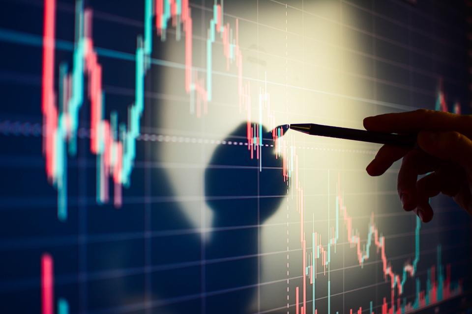 Business woman checking stock market data