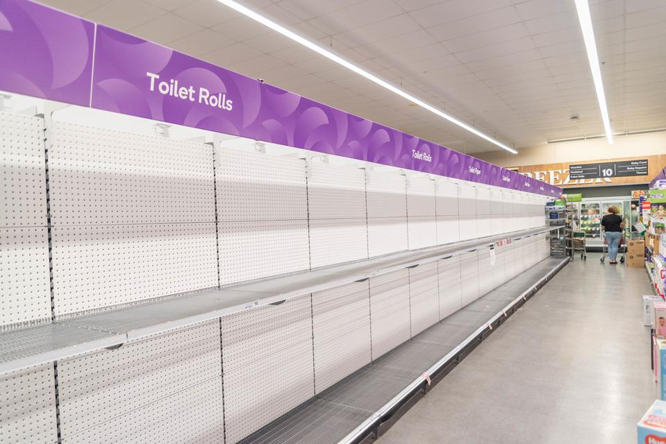 A view of Empty toilet roll shelves at a supermarket. Shops...