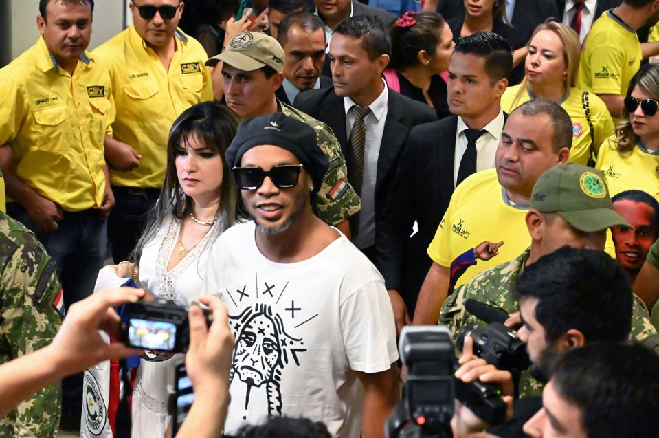 Ronaldinho's futsal team have won their futsal tournament and a suckling pig in prison