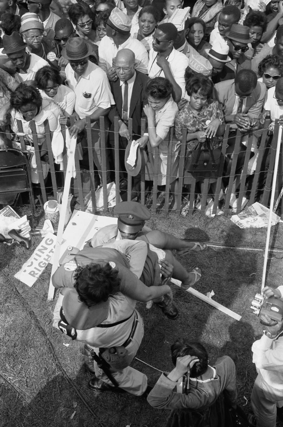Crowd of African Americans behind a storm fence during March on Washington for Jobs and Freedom, Washington