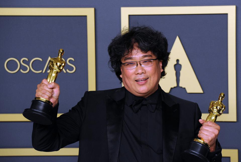 Bong Joon Ho with his two Oscars at the 92nd Annual Academy Awards - Press Room