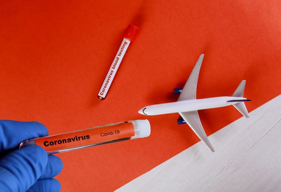 Novel coronavirus Covid-19 with test tube with blood plane