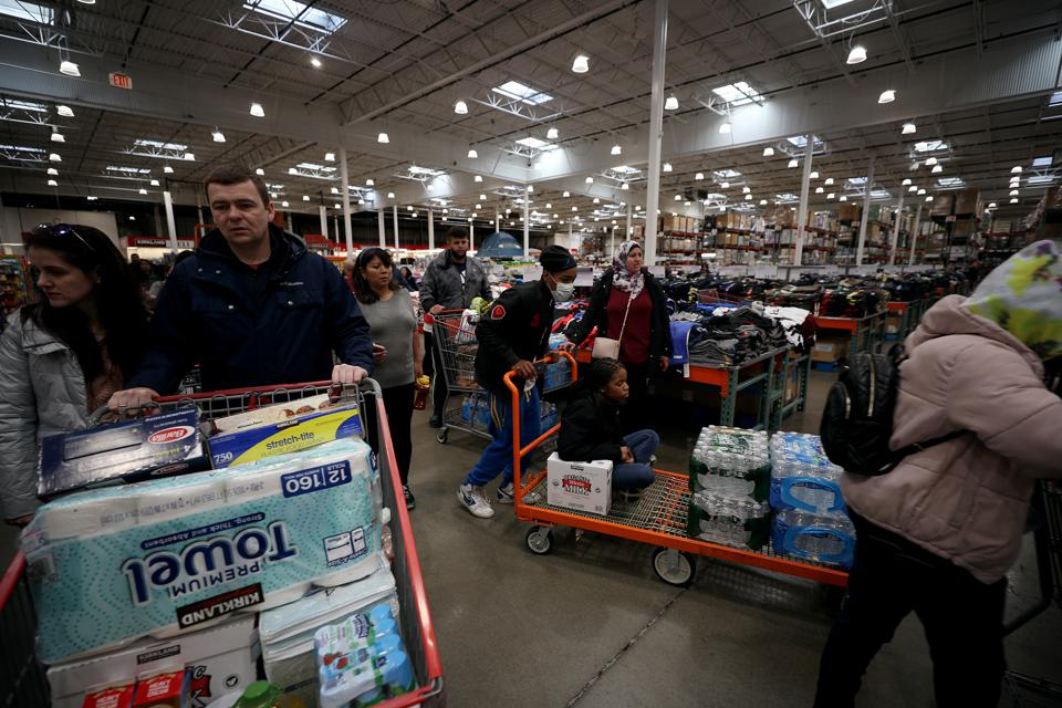 Americans rush to markets to stockpile water and cleaning products over coronavirus fears