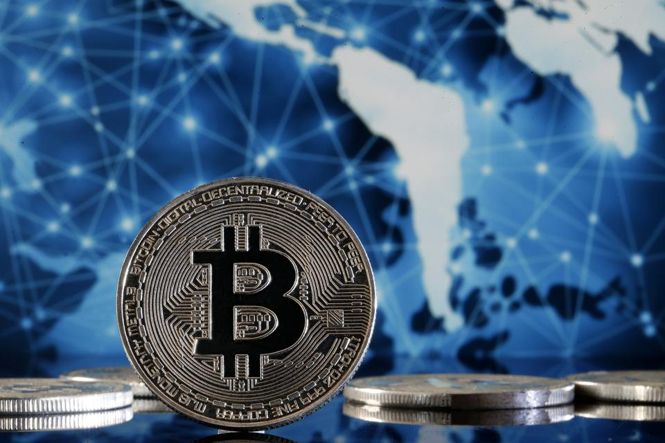 """<img src=″bitcoin.png″ alt=″Bitcoin Displayed Against A Background With The Earth″>"""" data-height=""""3456″ data-width=""""5184″></div> <p class="""