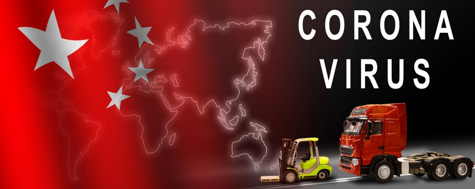 Freight transport with the inscription coronavirus. The concept on the spread of the 2019-vCoV virus during cargo transportation between countries