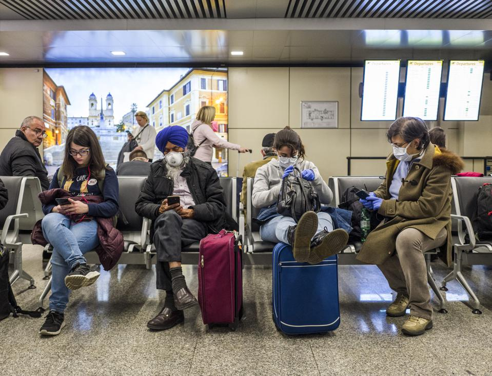 Italy Faces The Coronavirus airport rome flights cancelled travelers stranded