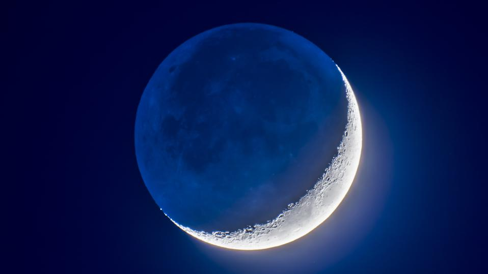The faint Earthshine on the dark side of the Moon. (Photo by: Alan Dyer/VWPics/Universal Images Group via Getty Images)