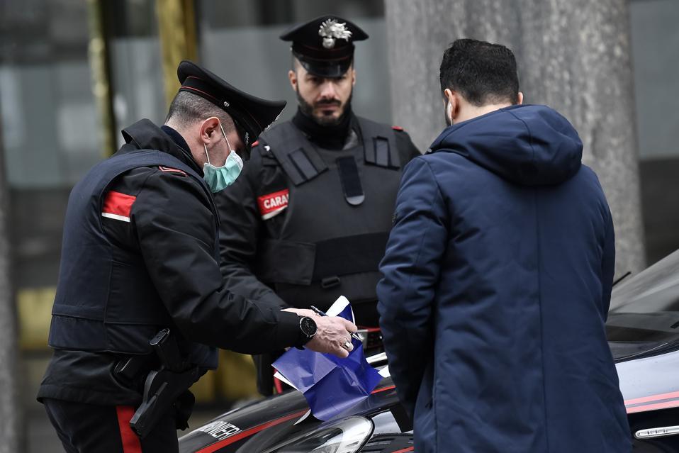 police check travel documents of pedestrian coronavirus pandemic italy lockdown