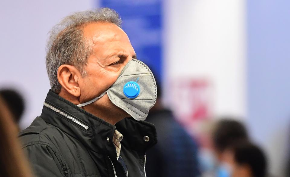 A traveller wearing a face mask arrives at Los Angeles International Airport on March 12.