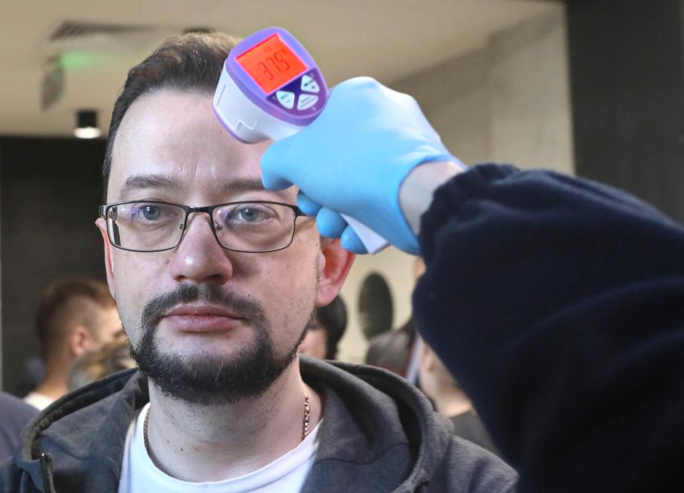 Attendees undergo temperature checks before governments offsite meeting in Kyiv