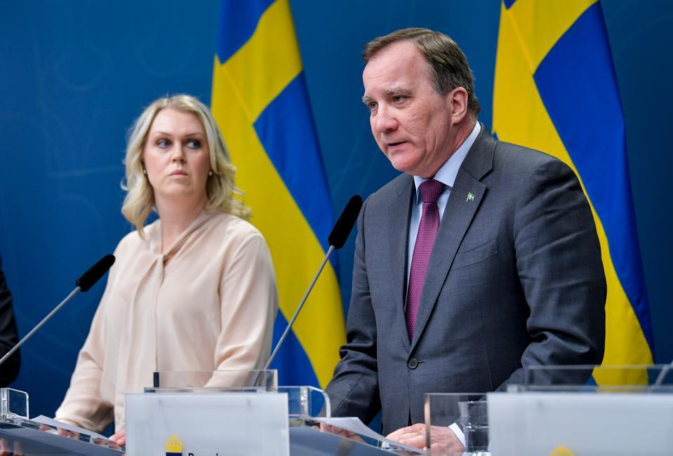 Social Minister Lena Hallengren (L) and Prime Minister Stefan Lofven