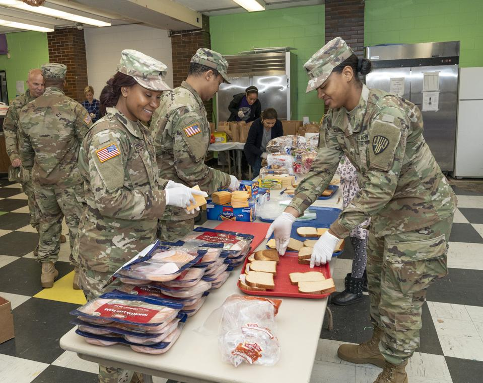 NEW YORK, UNITED STATES - 2020/03/13: Members of National Guard & volunteers prepare bags of food to residents near a one-mile radius containment area set up to halt spread of COVID-19 on 91 Lincoln Ave. (Photo by Lev Radin/Pacific Press/LightRocket via Getty Images)