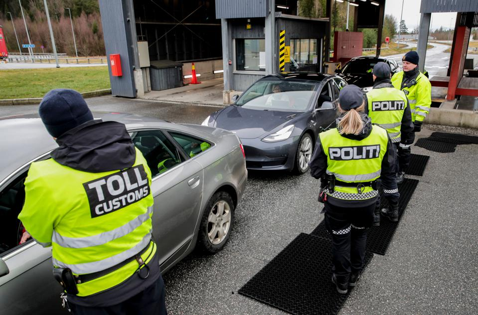 Norwegian Police and customs officers perform border checks on the Norway-Sweden border.