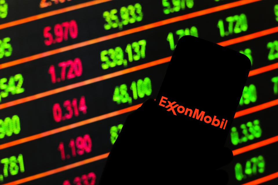 In this photo illustration an Exxon Mobil logo seen...