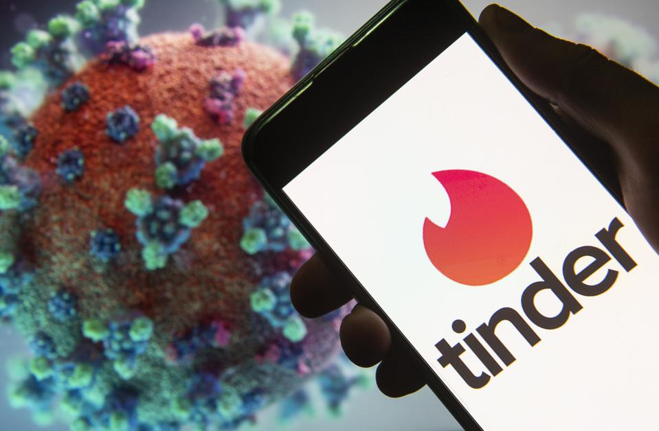 In this photo illustration a Tinder logo seen displayed on a...