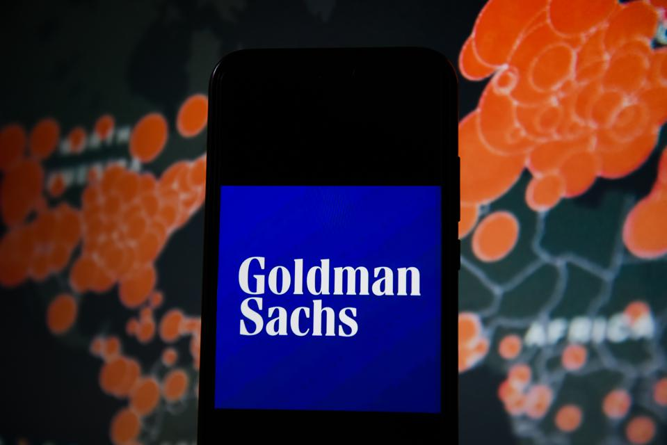 In this photo illustration a Goldman Sachs logo seen...