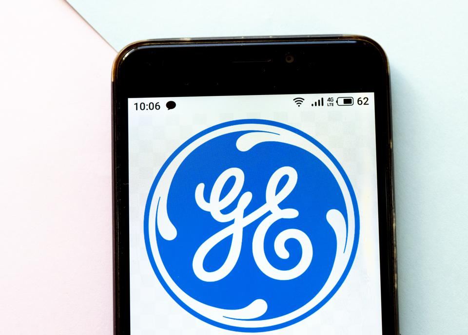 In this photo illustration a General Electric logo seen...