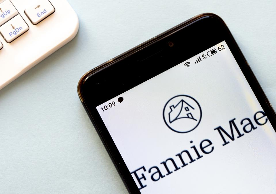 In this photo illustration a Fannie Mae logo seen displayed...