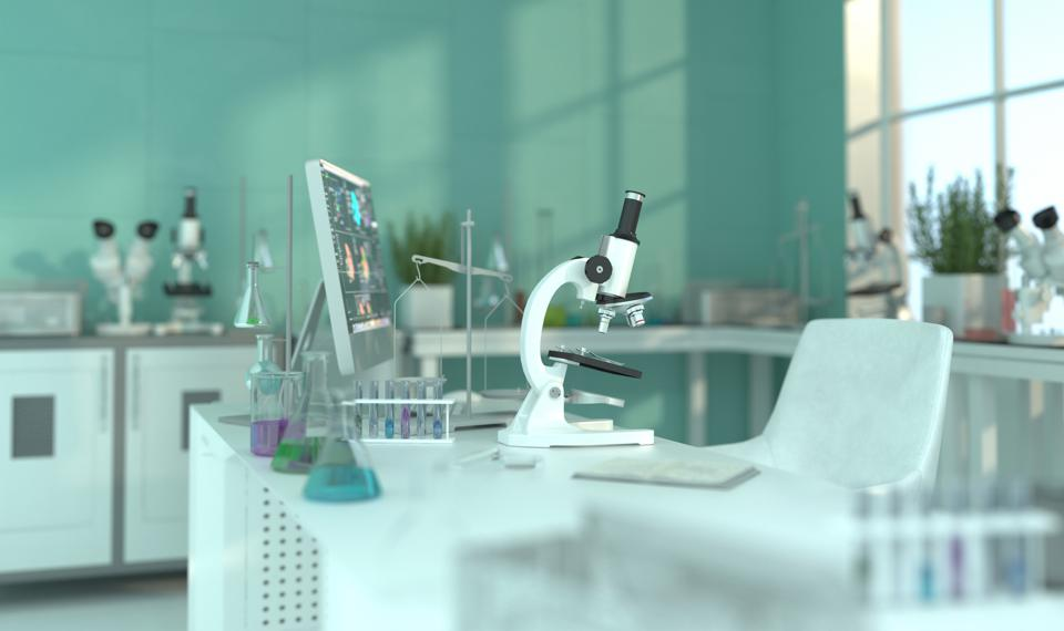 Interior of a medical office with laboratory equipment. Laboratory with a microscope on the table for scientific research. 3D rendering