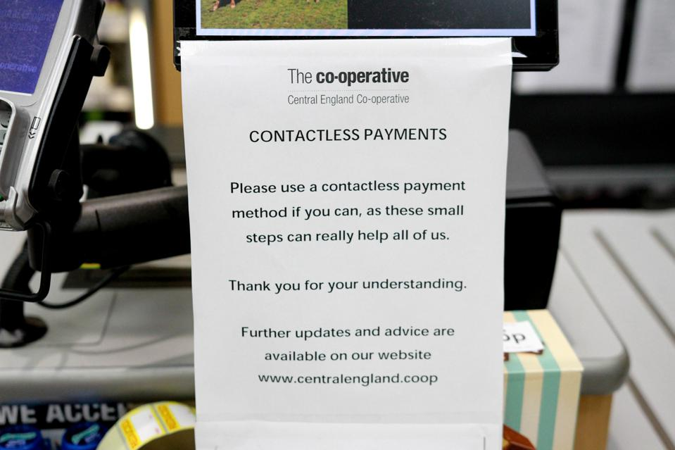 A sign saying 'contactless payments' at a Co-Operative Store...