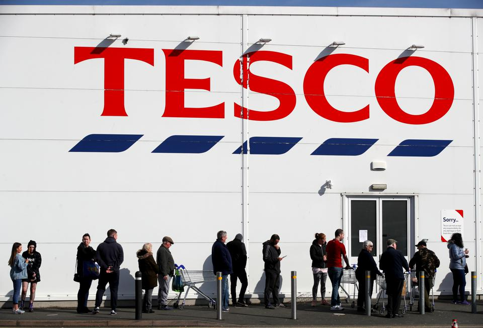Queuing outside a Tesco Extra store
