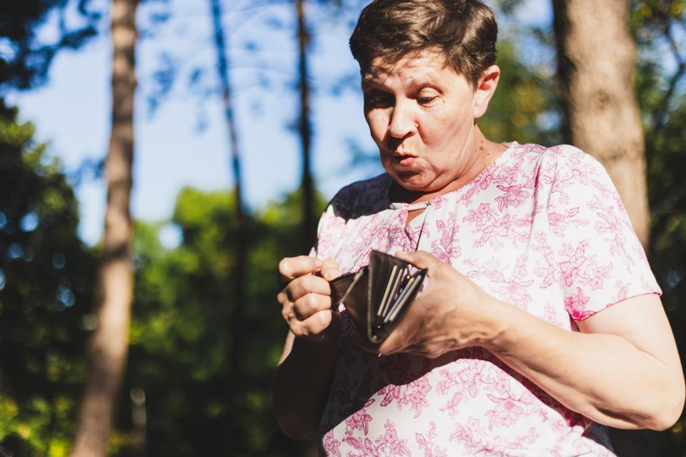 Old woman checking wallet
