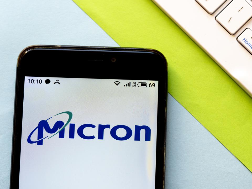 In this photo illustration a Micron logo seen displayed on a...