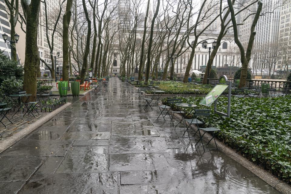 Virtually empty Bryant Park in Manhattan on first day of...