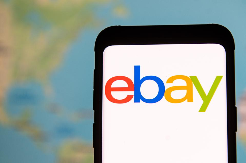In this photo illustration an Ebay logo seen displayed on a...