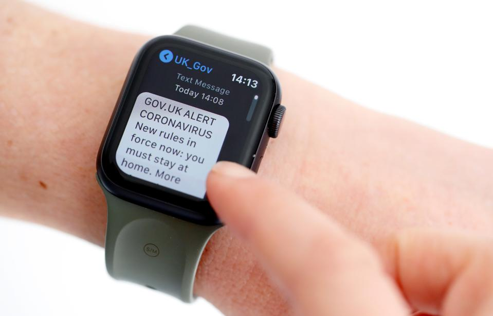 Smartwatch, where text reads 'GOV.UK CORONAVIRUS ALERT. New rules in force now″