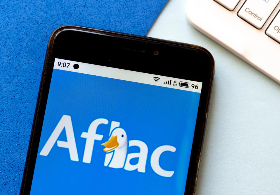 In this photo illustration an Aflac logo is seen displayed.