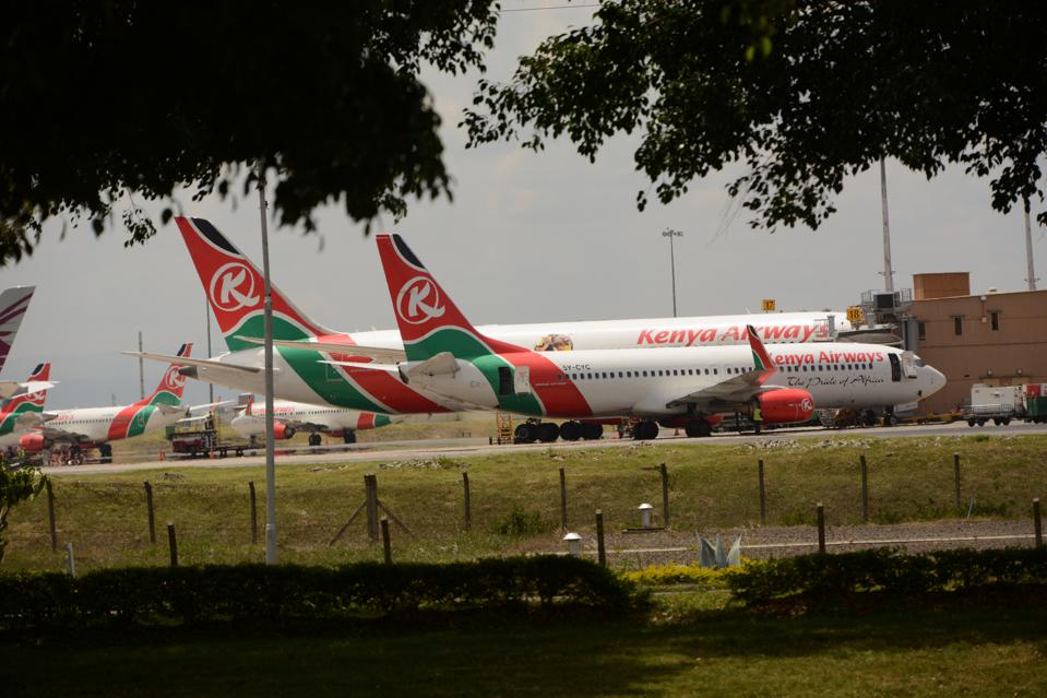Kenya Airways planes are parked at the Jomo Kenyatta...