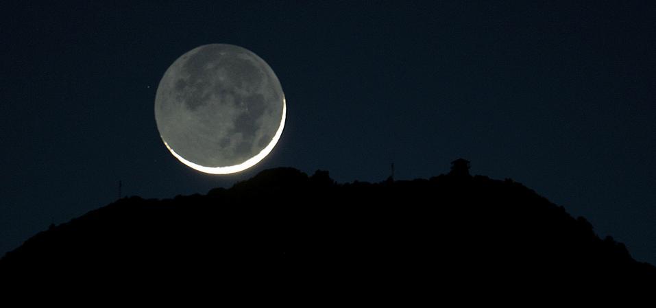 The crescent moon seen from Mill Valley set behind Mount Tamalpais