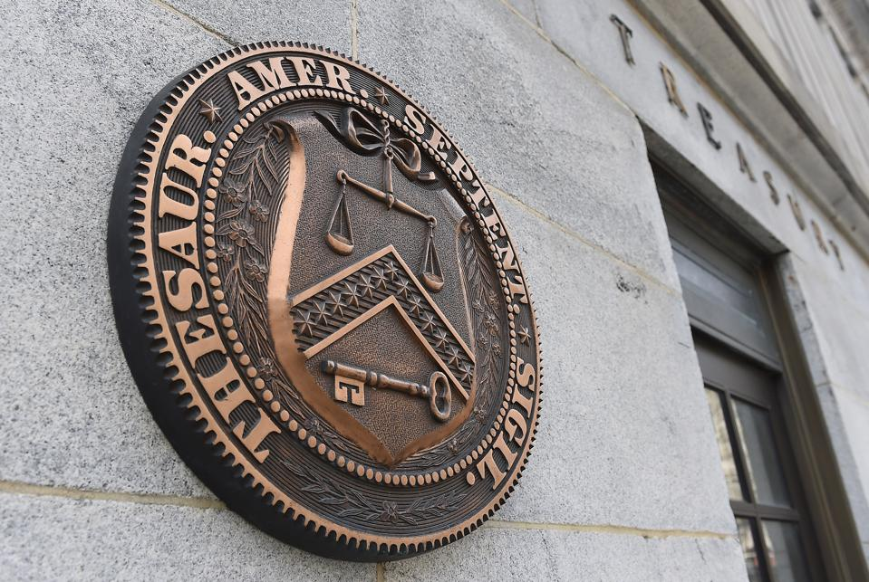External view of seal on Treasury Department building.
