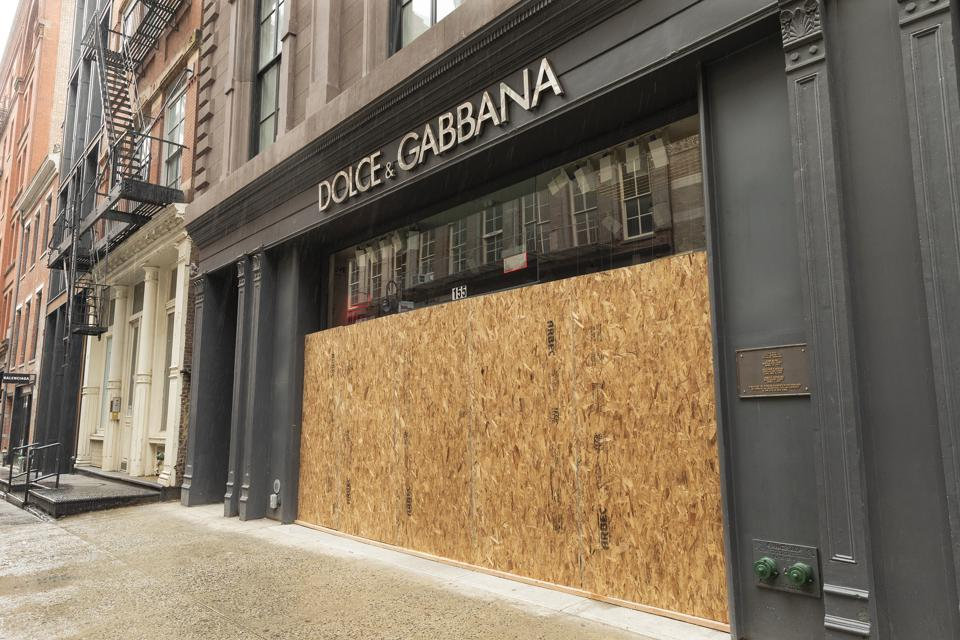 Dolce & Gabbana on Mercer Street boarded up its plywood windows and entrances to prevent looting in Manhattan. (Photo by Lev Radin/Pacific Press/LightRocket via Getty Images)