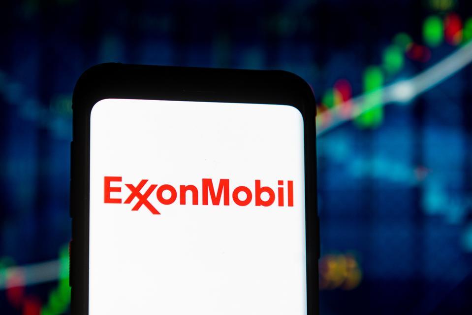 In this photo illustration an Exxon Mobil logo seen...