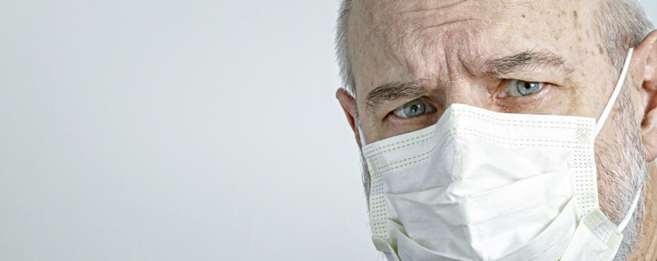 Close-Up of Senior Man Wearing Medical Surgical Face Mask