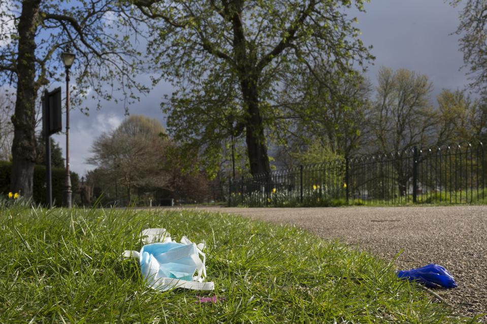 Coronavirus Discaded Mask and Glove In London Park