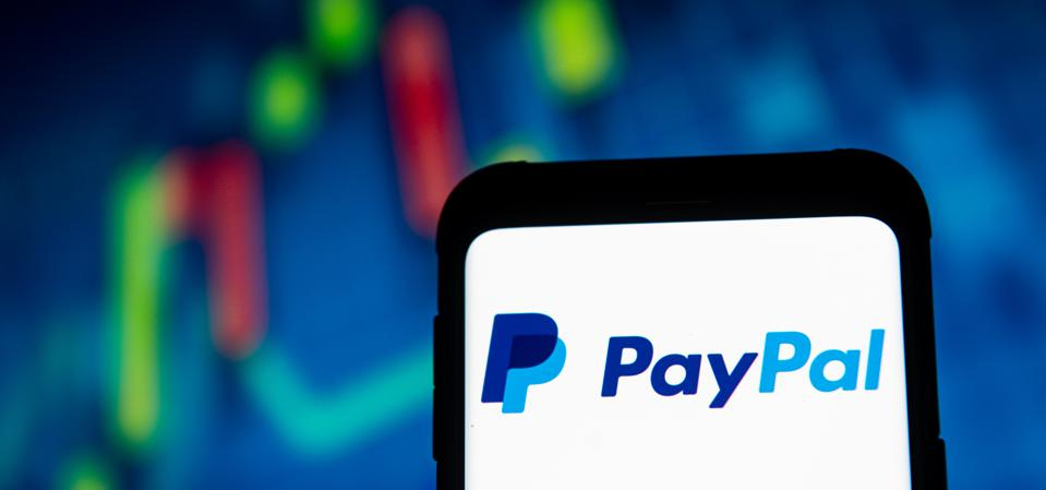 In this photo illustration a Pay Pal logo seen displayed on...