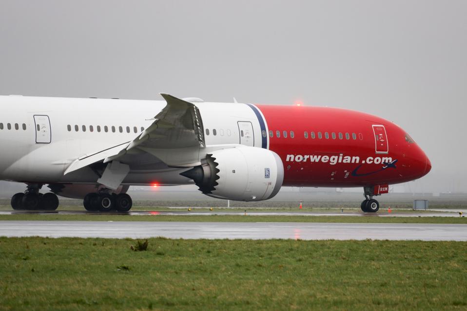 Norwegian Air Sweden Boeing 787-9 Dreamliner aircraft landing at Amsterdam Airport.