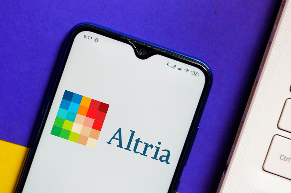 In this photo illustration the Altria logo is displayed on a...