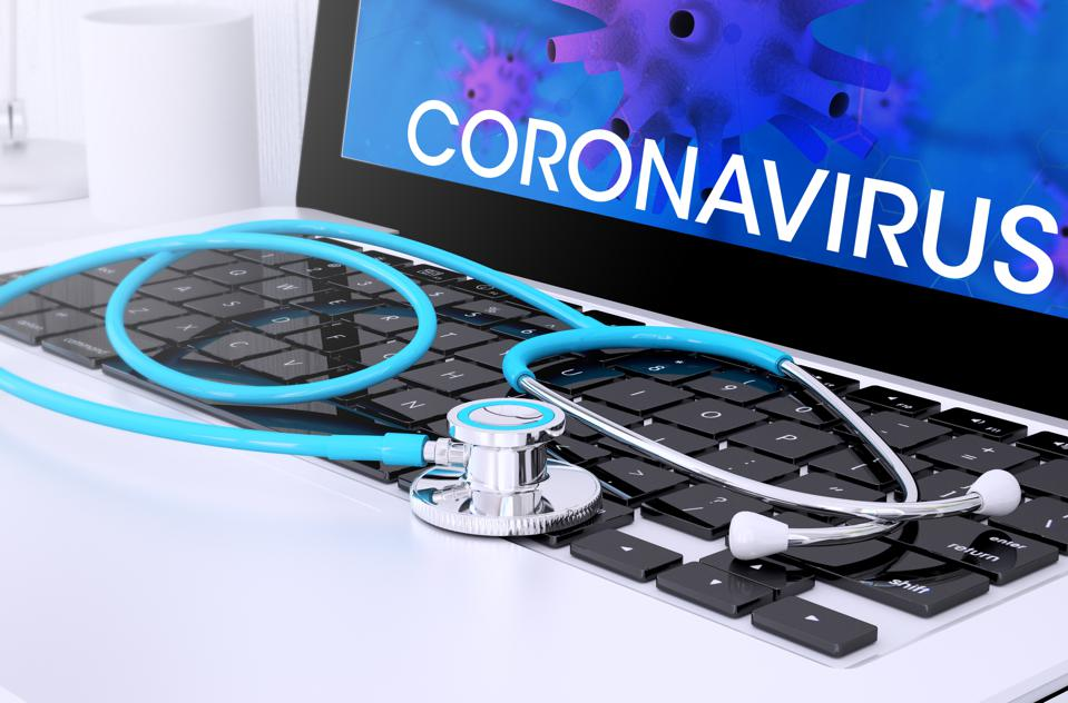stethoscope on laptop keyboard with screen showing coronavirus