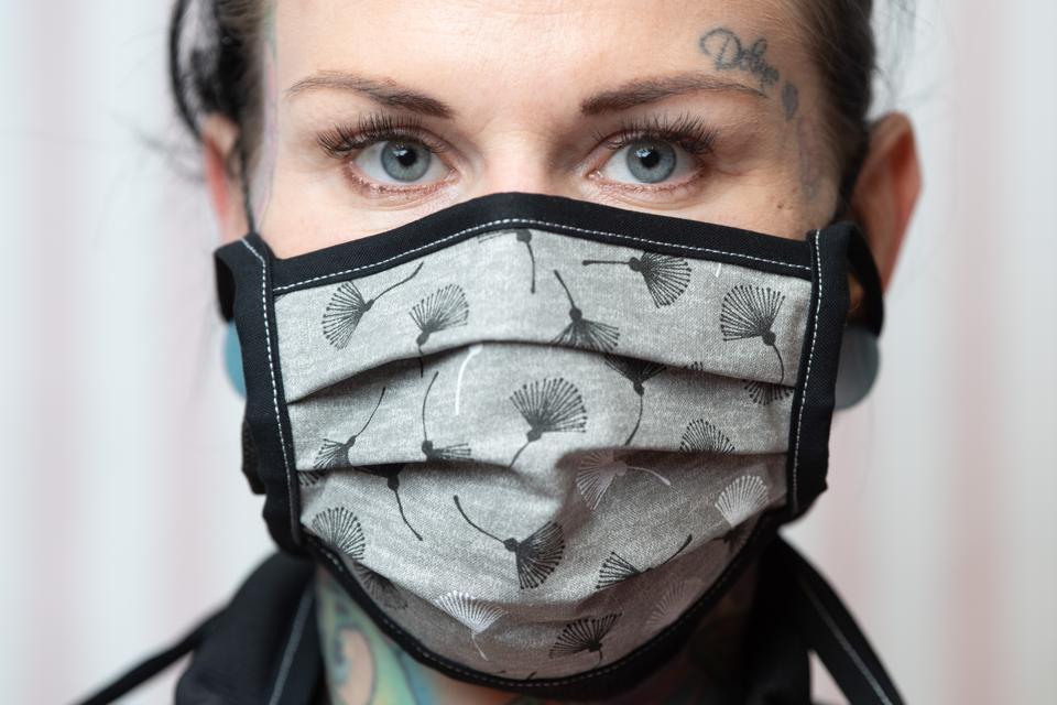 Daniela Beck, tattoo artist wears a self-stitched mouth guard.