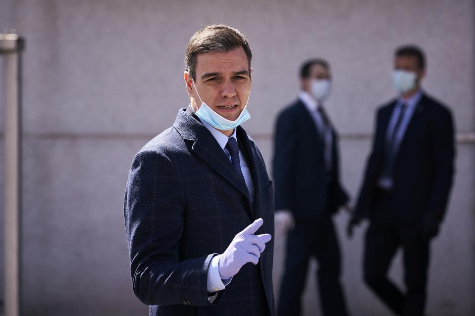 Prime Minister, Pedro Sanchez wearing a face mask as a...
