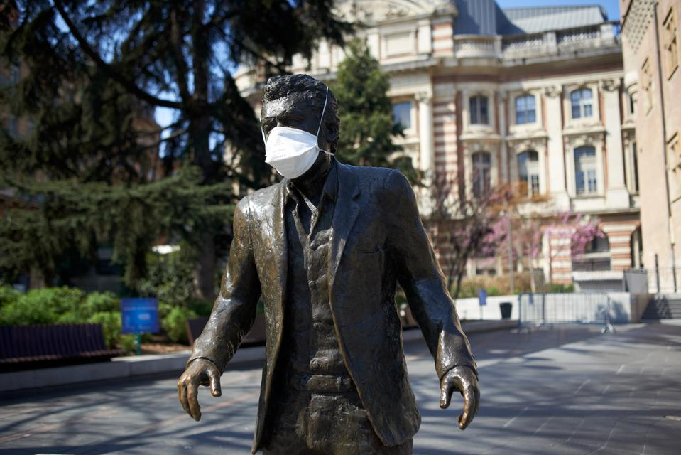 Someone has put a face mask on a statue of well known singer Claude Nougaro in Toulouse, France, on April 4, 2020.