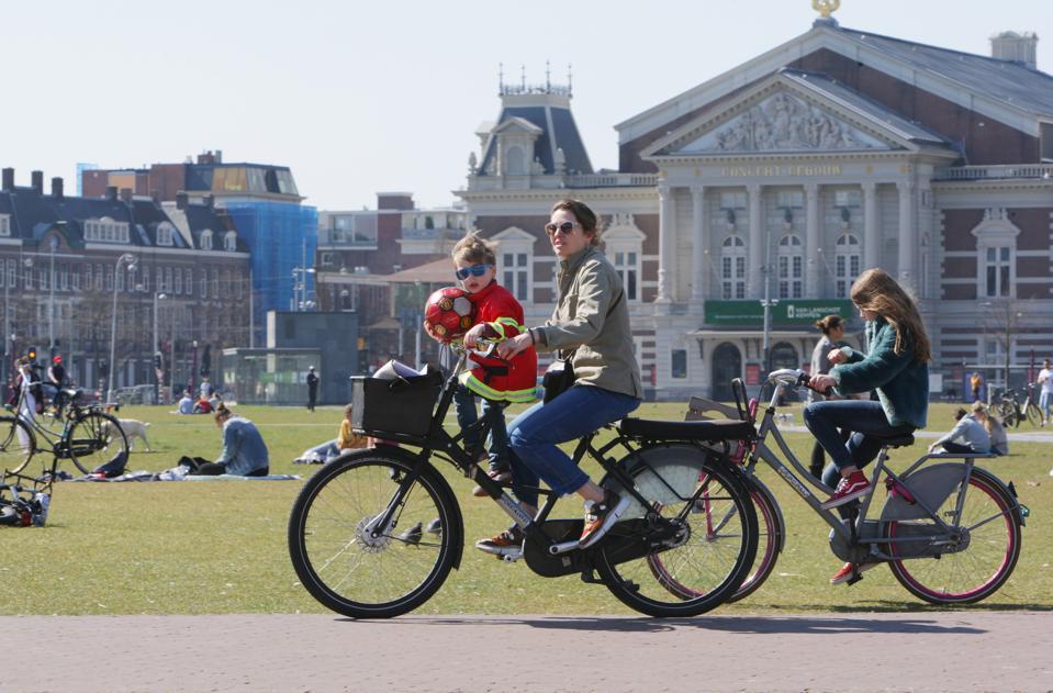 Locals enjoy a sunny day in Amsterdam