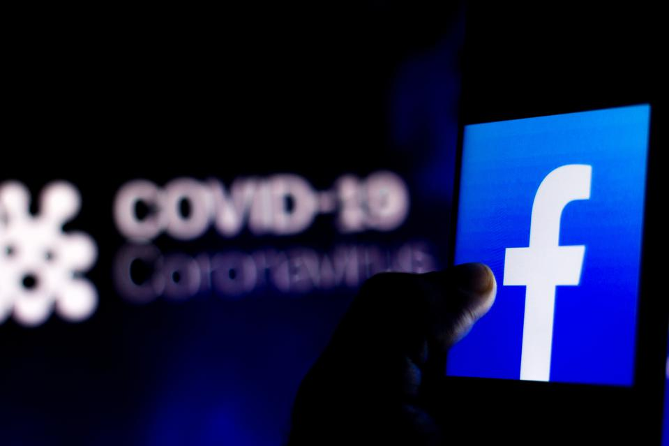 In this photo illustration the Facebook logo seen displayed...