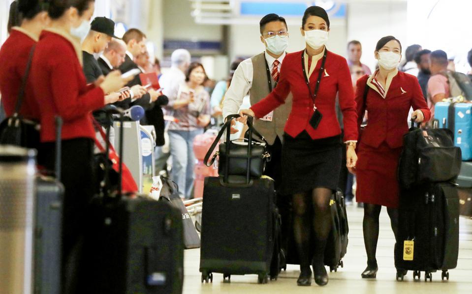 Flight Crews Wear Protective Gear For International Flights