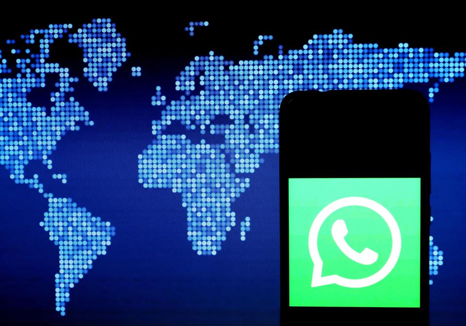 In this photo illustration a WhatsApp logo seen displayed on...