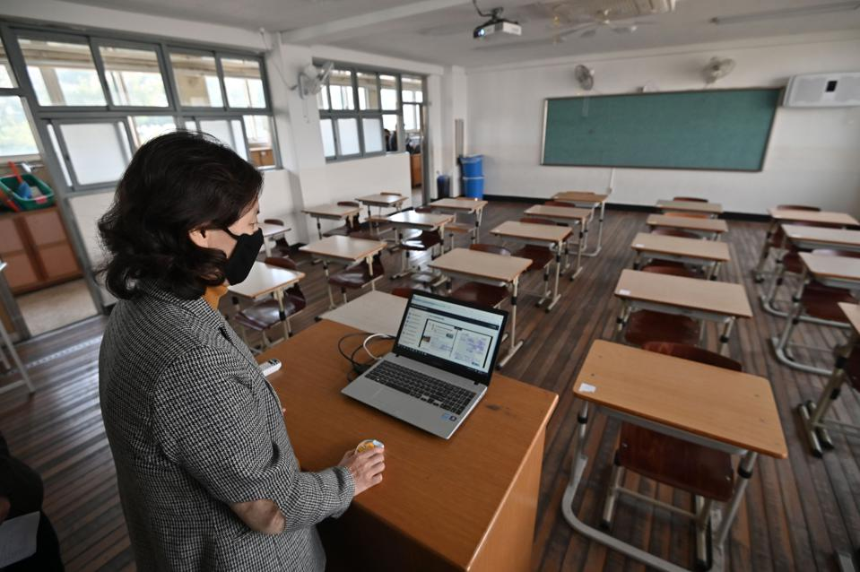 A teacher gives an online class to her students amid concerns over COVID-19.